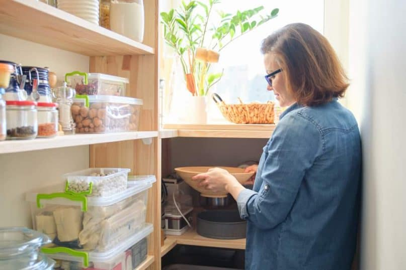 Store products in storage bins inside cabinets and pantries
